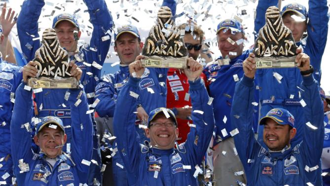Truck driver Mardeev of Russia celebrates on podium with co-pilots Belyaev and Svistunov after winning the seventh South American edition of the Dakar Rally 2015 in Buenos Aires